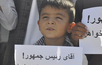 Afghans protest against civilian killing by armed militants