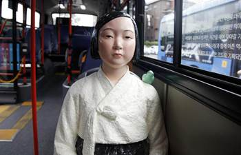 """Comfort women"" statues installed on buses in Seoul"