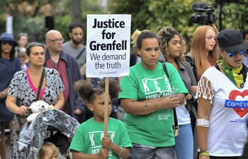 People march to pay respects to victims of Grenfell Tower fire