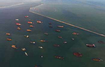 Ships anchored at port to take shelter from wind