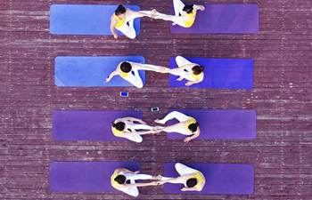 Women practice yoga in central China's Henan
