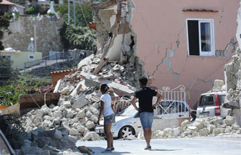 Rescuers race against time on Italy's Ischia Island, after quake kills two