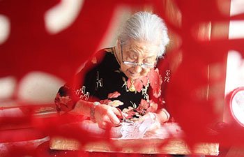 In pics: papercuttings made by 103-year-old woman