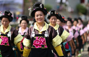"Miao people dance to celebrate ""Chixin Festival"" in SW China's Guizhou"