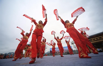 People take part in square dance competition in C China's Hunan