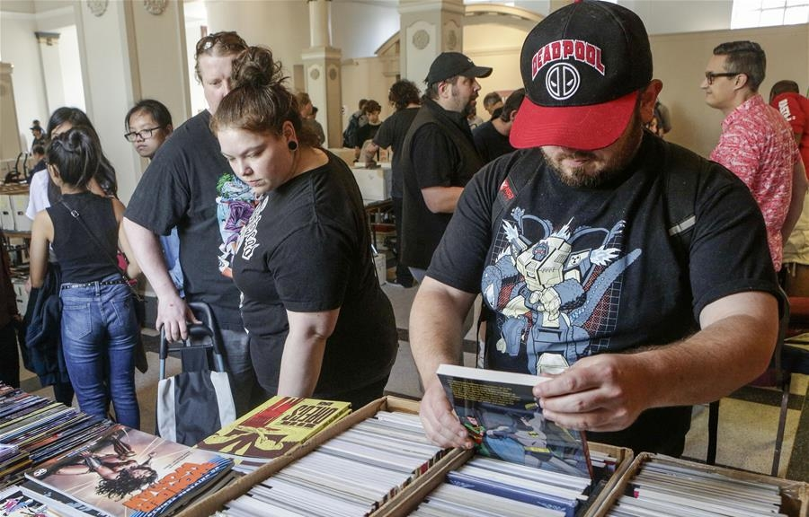 People view vintage comic books at comic book convention in Vancouver