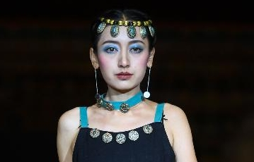 Models present fashion creations with Tibetan medicine designing characteristics in Lhasa