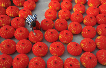Red lanterns made for upcoming National Day and Mid-Autumn Festival holidays