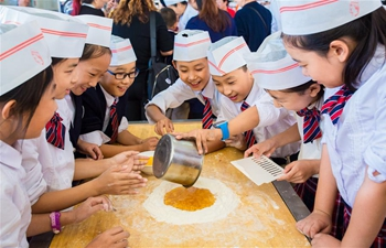 Pupils learn to make mooncakes in China's Inner Mongolia