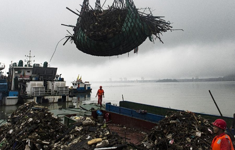 Sanitary workers clean rubbish at Three Gorges in China's Hubei