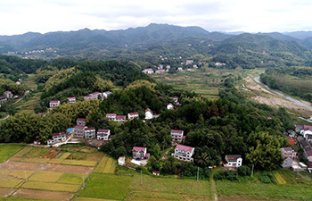 Township scenery at foot of E China's Dabie Mountains