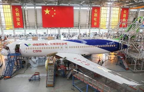 Workers complete paint spraying for C919 aircraft coded 102 in Shanghai