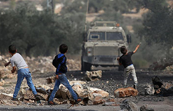 Israeli soldiers clash with Palestinian protesters near Nablus