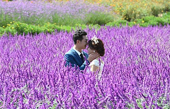 "Couples pose for wedding photos at ""love town"" in SW China"