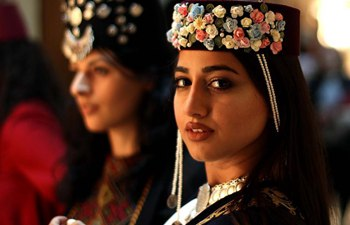 Models present traditional Armenian costumes in Jordan