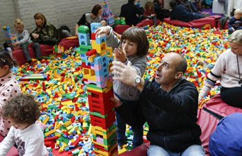 People play with Lego bricks at Lego bricklive convention in Brussels