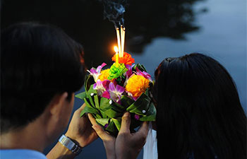 People celebrate traditional festival Loy Krathong in Thailand