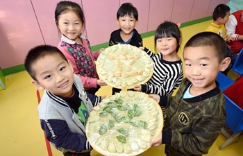 Children make dumplings to celebrate Beginning of Winter in N China