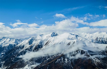 Aerial view of snow-covered Bayan Har Mountains in China's Qinghai