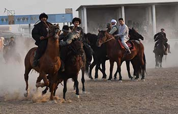 Afghan horsemen compete during game of Buzkashi
