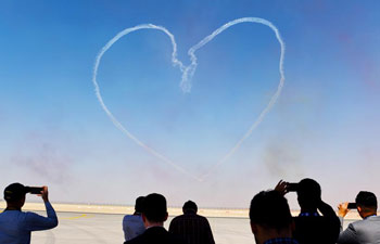 Al Fursan aerobatics demonstration team perform at Dubai Air Show