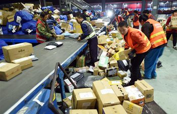 Workers busy dealing with parcels after Singles' Day