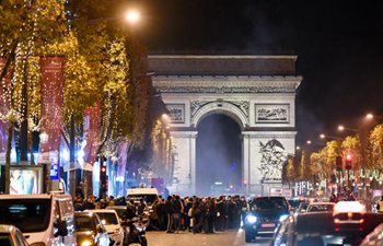 Christmas lights illuminate Champs Elysees avenue in Paris
