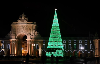 Huge Christmas tree lit up in downtown Lisbon