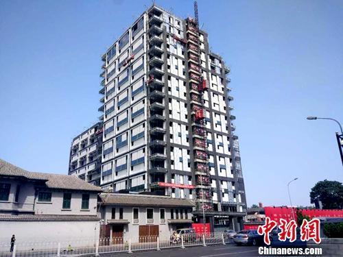 北京一处正在建设的楼房。<a target='_blank'  data-cke-saved-href='http://www.chinanews.com/' href='http://www.chinanews.com/' ><p  align=