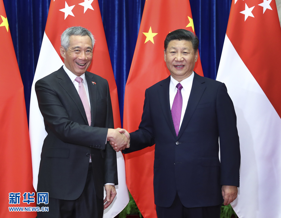 9月20日,国家主席习近平在北京人民大会堂会见来华进行正式访问的新加坡总理李显龙。 新华社记者 谢环驰 摄