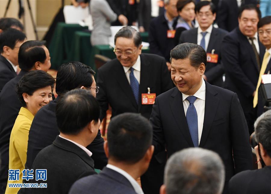 (两会·XHDW)(3)习近平看望参加政协会议的民进农工党九三学社委员