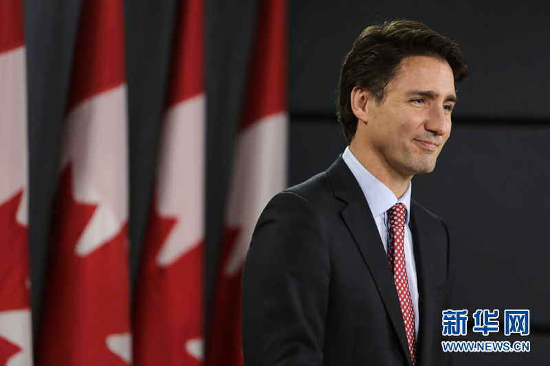 加拿大自由党领袖特鲁多举行获胜后首场新闻发布会