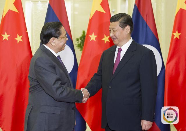 2014年7月28日,习近平同老挝人民革命党中央总书记、国家主席朱马图片