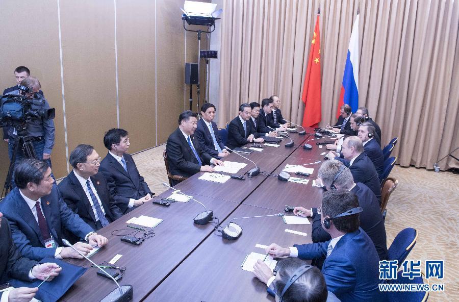 6月8日,国家主席习近平在阿斯塔纳会见俄罗斯总统普京。 新华社记者李涛 摄