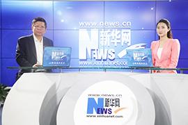 黃群在新華網訪談間