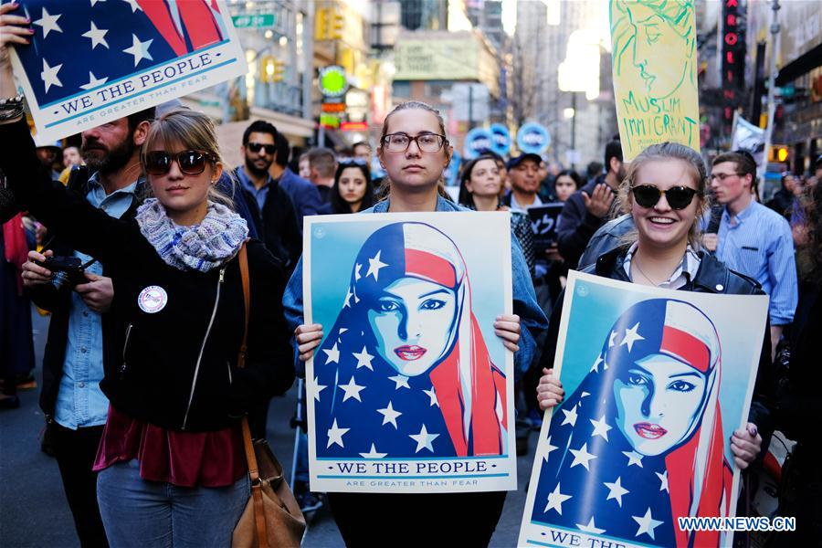 Spotlight: New Yorkers rally in Times Square against Trump ...