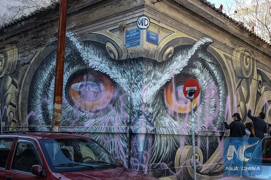 Feature: Preserving contemporary graffiti art on walls of Athens ...
