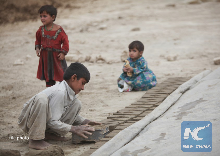 Feature: Afghan kids forced to make money on war-torn city