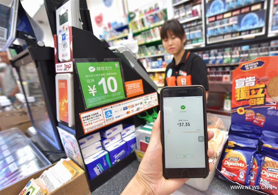 Hk 39 s convenience stores introduce wechat payment xinhua for Mobili convenienti
