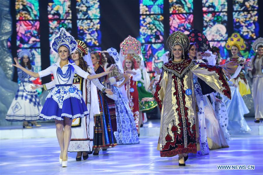 Contestants from Russia present traditional costumes at the China, Mongolia and Russia beautiful angels competition in Manzhouli, north China's Inner Mongolia Autonomous Region, Dec. 23, 2017. A total of 60 contestants participated in the pageant's final. (Xinhua/Liu Lei)<br/>