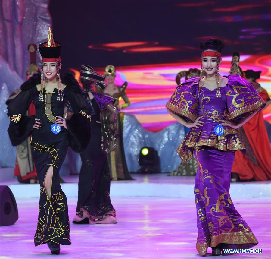 Contestants from Mongolia present traditional costumes at the China, Mongolia and Russia beautiful angels competition in Manzhouli, north China's Inner Mongolia Autonomous Region, Dec. 23, 2017. A total of 60 contestants participated in the pageant's final. (Xinhua/Liu Lei)<br/>