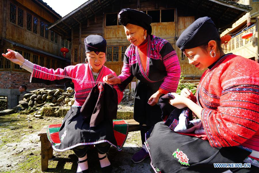 Elderly Woman Makes Traditional Clothes Of Yao People In S Chinas Guangxi