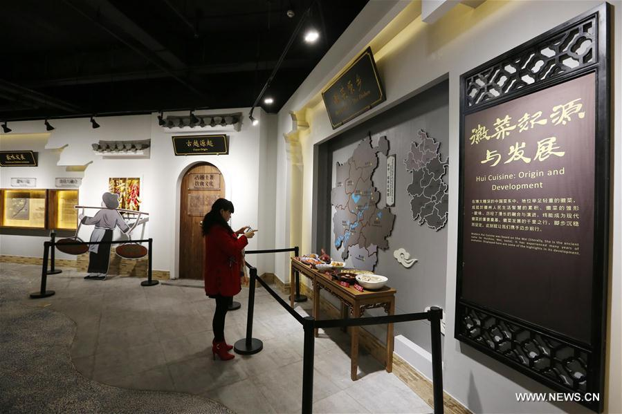 A woman takes photos at the Anhui Cuisine Museum in Huangshan City, east China's Anhui Province, Jan. 18. 2018. The museum opened to public on Thursday and introduces the history and culture of making Anhui Cuisine. (Xinhua/Shi Yalei)<br/>