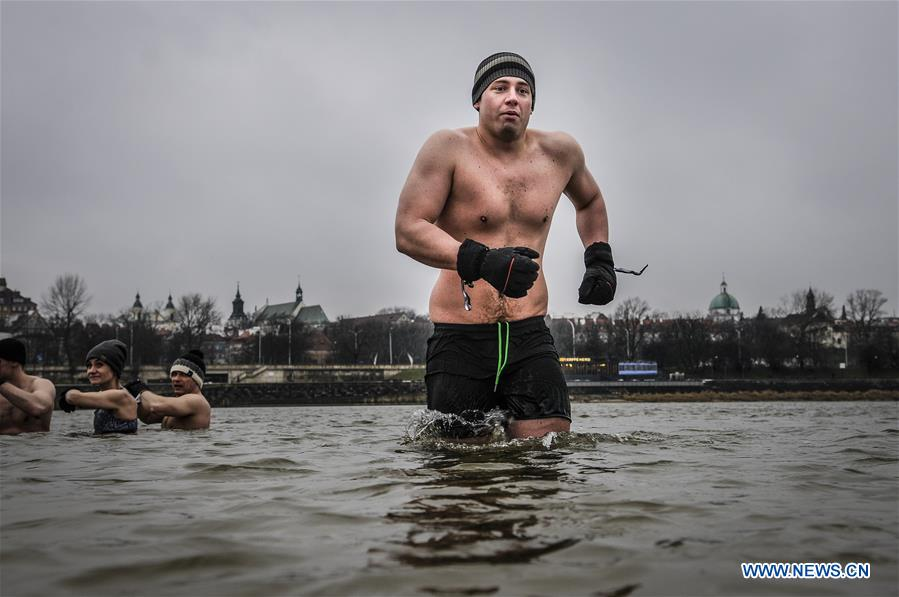 Enthusiasts stay in ice cold waters of Vistula river in Warsaw