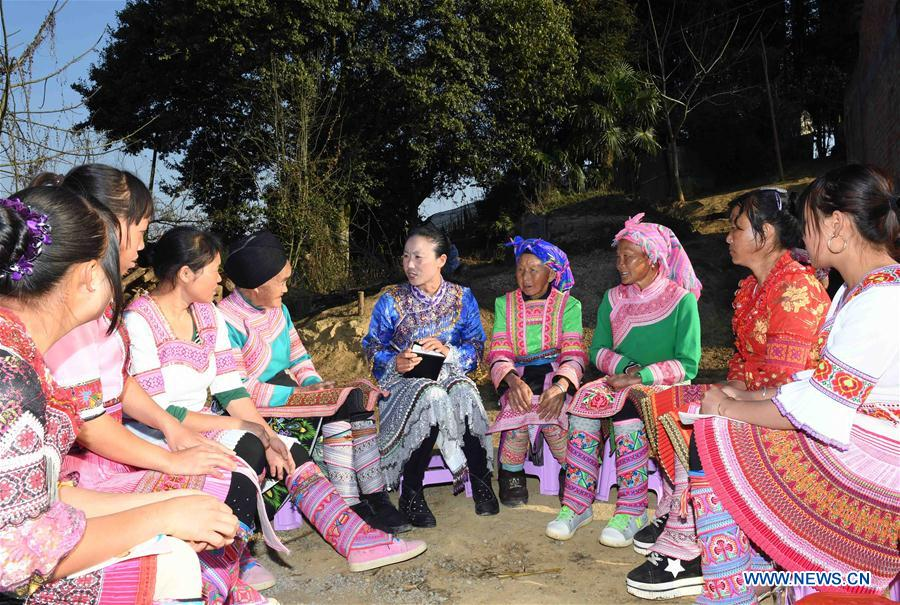 Doctor Yang Lianying of Miao ethnic group, a newly-elected deputy to the 13th National People's Congress, solicits opinions from villagers on green development and healthy life as she visits a village in southwest China's Yunnan Province, Feb. 24, 2018. Yang believes that green development should be focused on during poverty alleviation in remote mountainous areas. China's annual political sessions of the National People's Congress (NPC) and the National Committee of the Chinese People's Political Consultative Conference (CPPCC) are scheduled to convene in March, 2018. During the two sessions, development agendas will be reviewed and discussed, and key policies will be adopted. Year 2018 marks the first year of fully implementing the spirit of the 19th National Congress of the Communist Party of China, which vowed to pursue the vision of innovative, coordinated, green, and open development that is for everyone. The CPC congress stressed that building an ecological civilization is vital to sustain the Chinese nation's development, &quot;we must realize that lucid waters and lush mountains are invaluable assets.&quot; (Xinhua/Yang Zongyou)<br/>