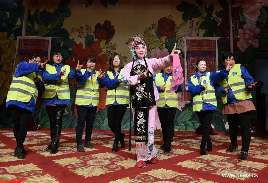 CHINA-BEIJING-PEKING OPERA-WOMEN'S DAY-WORKER-VISIT (CN)