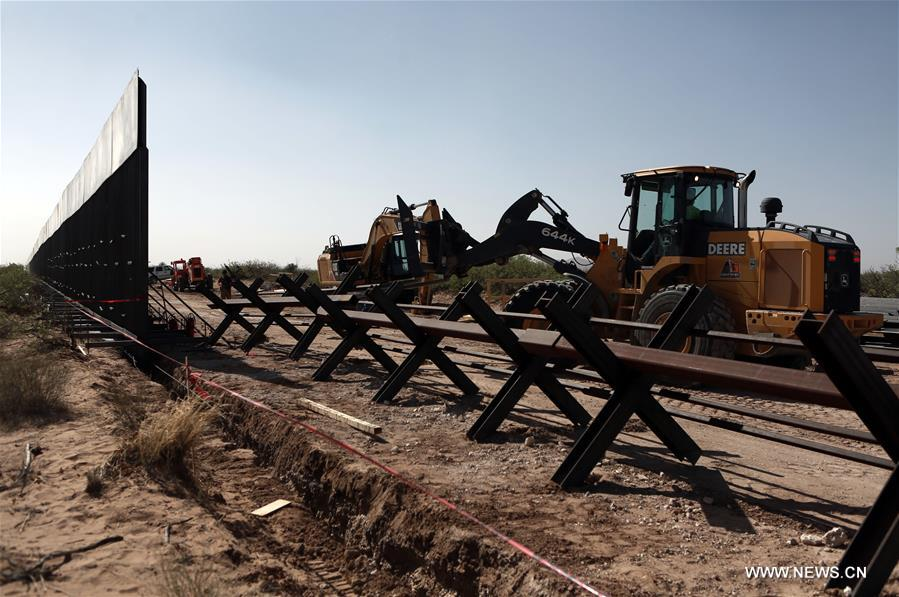 In pics: construction of new border wall between Mexico