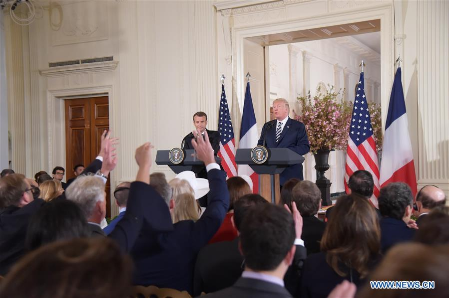U.S. President Donald Trump (R, Rear) and French President Emmanuel Macron (L, Rear) attend a joint press conference at the White House in Washington D.C., the United States, April 24, 2018. Macron is on a state visit to the United States from Monday to Wednesday. (Xinhua/Yang Chenglin)<br/>