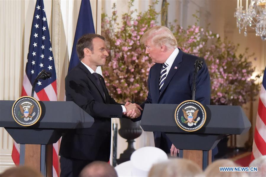 U.S. President Donald Trump (R) and French President Emmanuel Macron attend a joint press conference at the White House in Washington D.C., the United States, April 24, 2018. Macron is on a state visit to the United States from Monday to Wednesday. (Xinhua/Yang Chenglin)<br/>