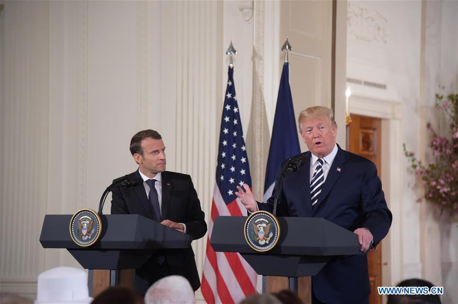 U.S. President Donald Trump (R) and French President Emmanuel Macron attend a joint press conference at the White House in Washington D.C., the United States, April 24, 2018. Macron is on a state visit to the United States from Monday to Wednesday. (Xinhua/Yang Chenglin)